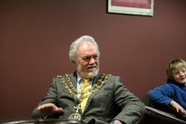 Dolphin-Centre Mayor-Lee listening-to-his-Mandolin